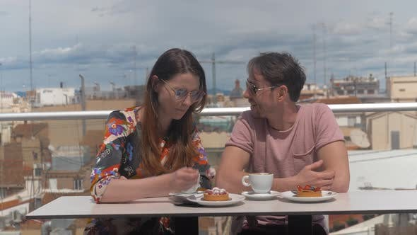 A Couple in an Outside Cafe on a Sunny Day