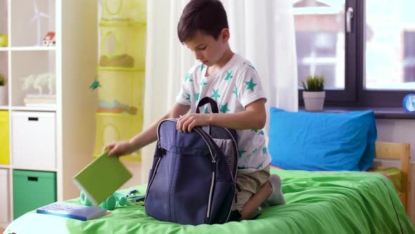 Thumbnail for Boy Packing Schoolbag with School Supplies at Home 13