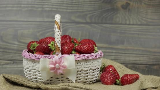 Thumbnail for Strawberries in a Small Basket on the Wooden Table - Close Up