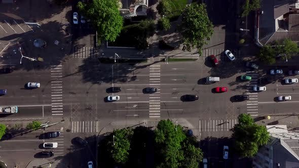 Thumbnail for Drone's Eye View - Aerial View of the Vehicular Intersection, Fly Under Trees.
