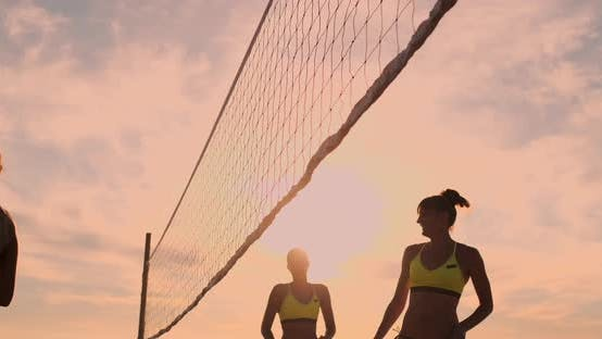 Thumbnail for Group of Young Girls Playing Beach Volleyball During Sunset or Sunrise, Slow Motion,