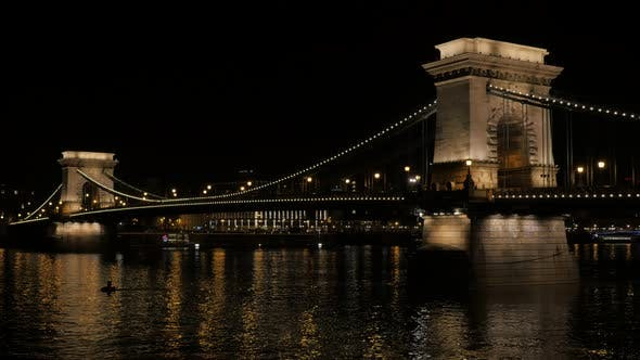 Famous Chain Szechenyi Bridge by night in Budapest Hungary and Danube 4K 2160p UltraHD ffps ootage -