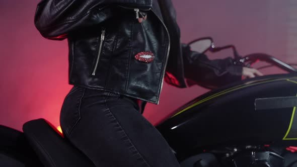 Thumbnail for Beautiful Young Woman Posing on a Motorcycle