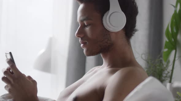 Thumbnail for Man Listening to Music after Waking Up