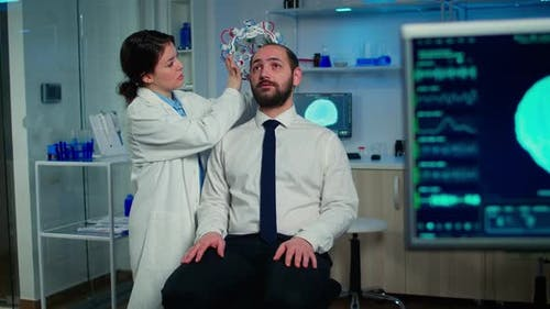 Medical Researcher Putting Performant Brainwave Scanning Headset