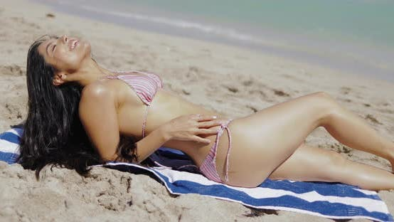 Thumbnail for Beautiful Fit Girl in Bikini Sitting on Sand