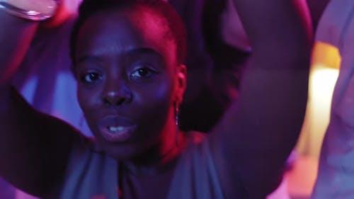 Black Woman Dancing at Party