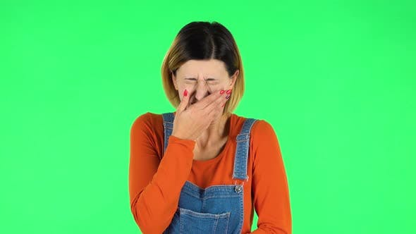 Cover Image for Girl Got a Cold, Sore Throat and Head, Cough on Green Screen at Studio