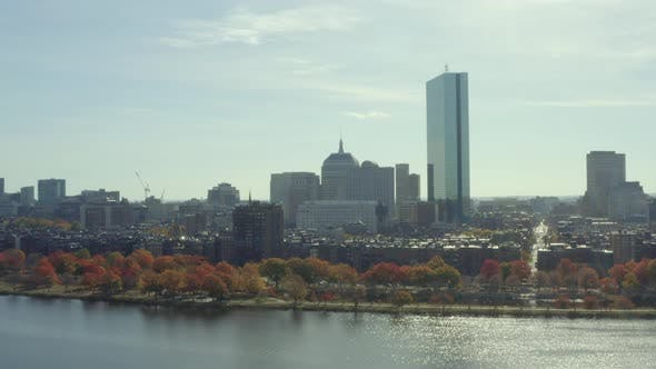 Riser reveal of Back Bay from Charles River