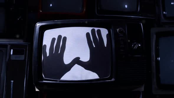 Thumbnail for Hands Reaching Out inside a Retro TV.