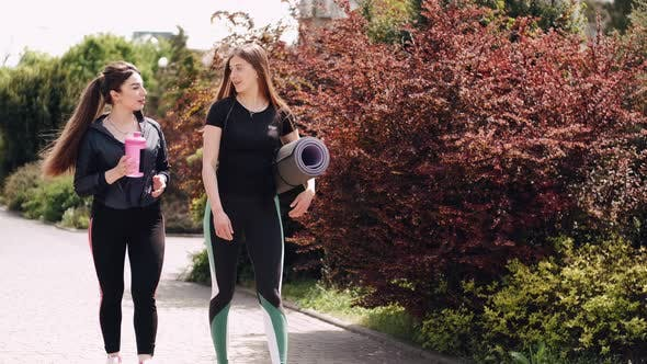 Thumbnail for Pretty Sporty Ladies with the Sports Equipment Are Talking and Going for a Training