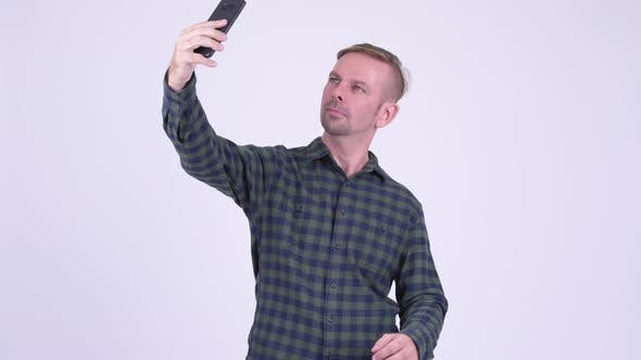 Thumbnail for Portrait of Happy Blonde Hipster Man Taking Selfie with Phone