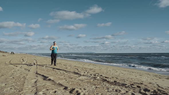 Thumbnail for Fat Man Overweight Doing Jogging Exercises On Sandy Sea Shore