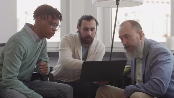 Three Diverse Businessmen Talking