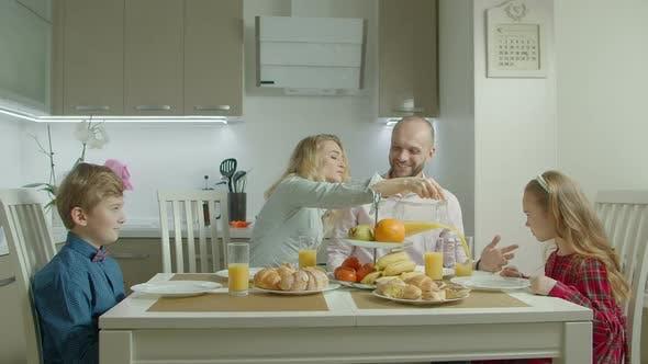 Thumbnail for Happy Family Having Healthy Breakfast in Kitchen