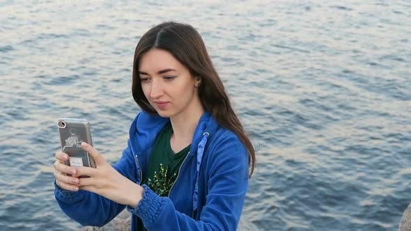 Cover Image for Girl Makes Selfie On The Background Of The Sea 3