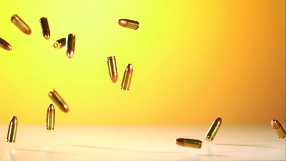 Thumbnail for Bullets falling bouncing in ultra slow motion 1500fps on a reflective surface - BULLETS PHANTOM