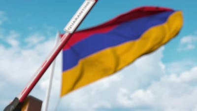 Barrier with QUARANTINE Sign Being Closed at Flag of Armenia