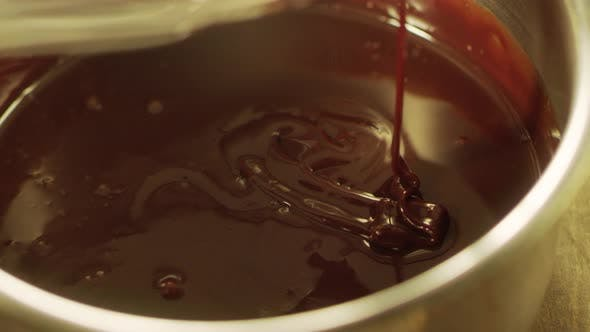 Thumbnail for Mixing Liquid Chocolate with Whisk in Slow Motion. Closeup Liquid Hot Chocolate.