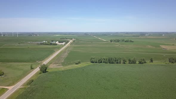 Thumbnail for Aerial of Minnesota Farmland Cropland and Farms in Summer Soybeans Country Road
