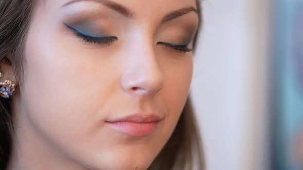 Makeup Artist Applies Mascara.