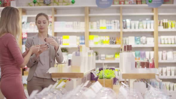 Thumbnail for Beauty Consultant Recommending Products to Customer at Store