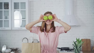 Woman with fresh apple eyes. Portrait of happy woman closing eyes by apples