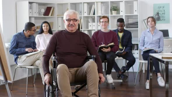Thumbnail for Portrait of Disabled Teacher and Multiethnic Students
