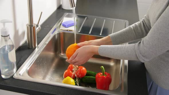 Thumbnail for Woman Washing Fruits and Vegetables in Kitchen