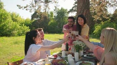 Friends Celebrating Something In Park