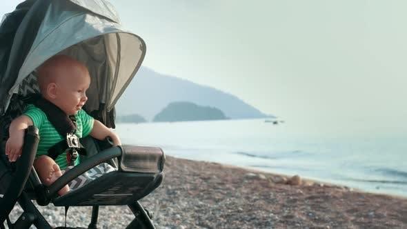 Baby Sitting in Stroller on Beach
