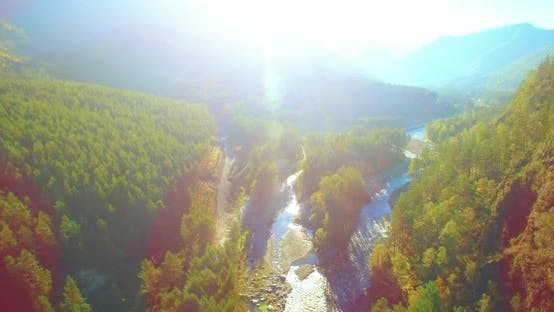 Thumbnail for Mid Air Flight Over Fresh Mountain River and Meadow at Sunny Summer Morning. Rural Dirt Road Below.
