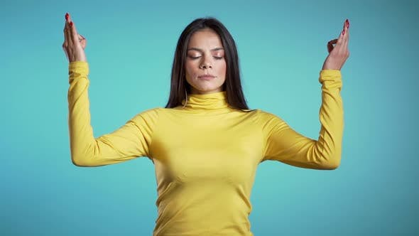 Thumbnail for Calm girl in yellow relaxing, meditating, Woman calms down, breathes deeply with mudra om