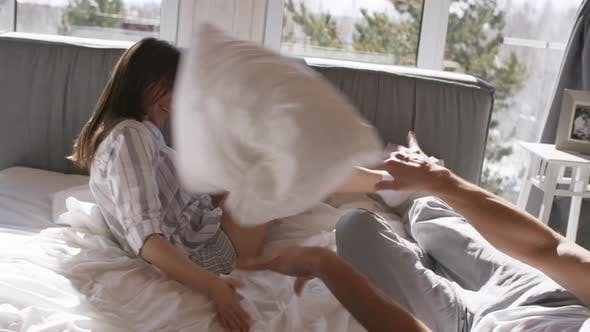 Thumbnail for Happy Couple Pillow Fighting in Bed