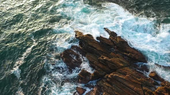 Thumbnail for Ocean Waves Crash Against Stony Rocks During Sunrise on the Island of Sri Lanka. Aerial View