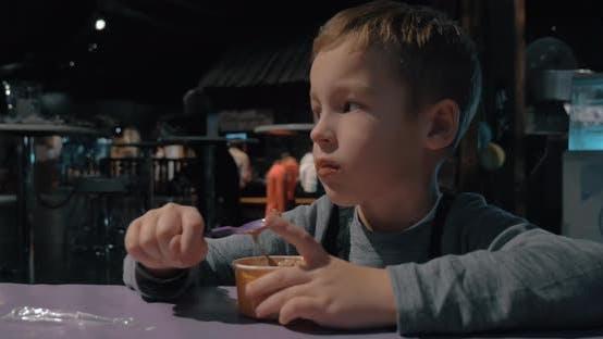 Thumbnail for Child enjoying ice-cream in cafe