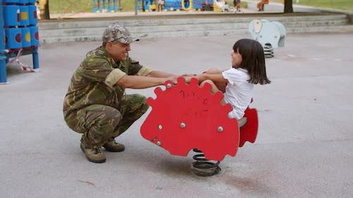 Military Daddy Playing with Active Kid Outdoors