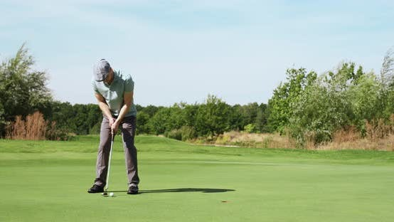 Thumbnail for Perfect Golf Putt. Male Golfer Hitting Ball and Enjoying Goal, Playing Outdoor at Green Course