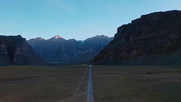 Cover Image for Aerial Forward Moving Shot of a Himalayan Road in Spiti Valley , Himachal Pradesh , Vertigo Effect
