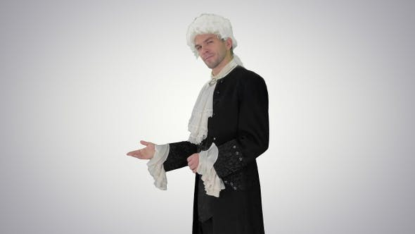 Thumbnail for Man in 18th century camisole and wig doing welcoming gesture