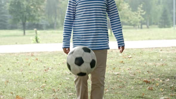 Thumbnail for Boy Training with Football