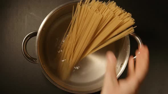 Thumbnail for A Cook Puts Down A Spaghetti In A Steel Pot