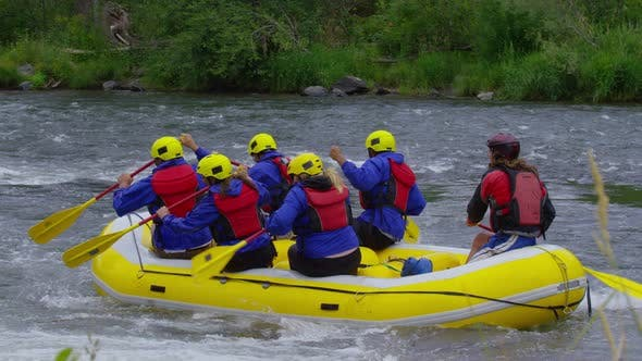 Thumbnail for Group of people white water rafting