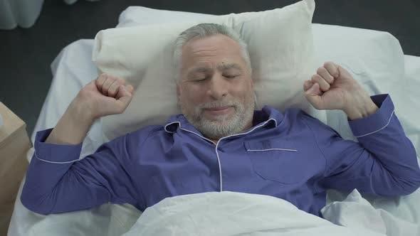 Thumbnail for Elder Basking in His Bed Rejoicing at New Orthopedic Mattress, Comfortable Sleep