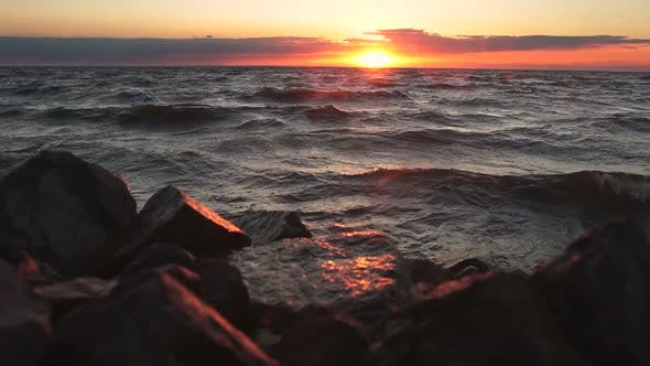 Thumbnail for Red Sky Over a Rocky Seashore. Sunset Landscape.