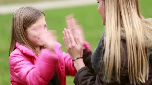 Thumbnail for Mom and daughter playing clapping game