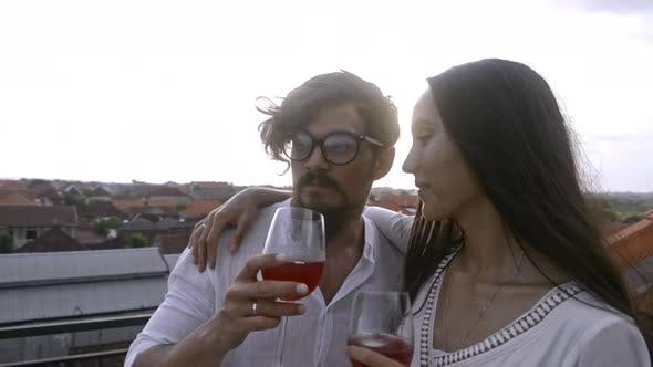 Thumbnail for Romantic Couple Drinking Wine on Rooftop