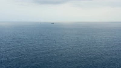 Oil tanker with tugboat on the horizon