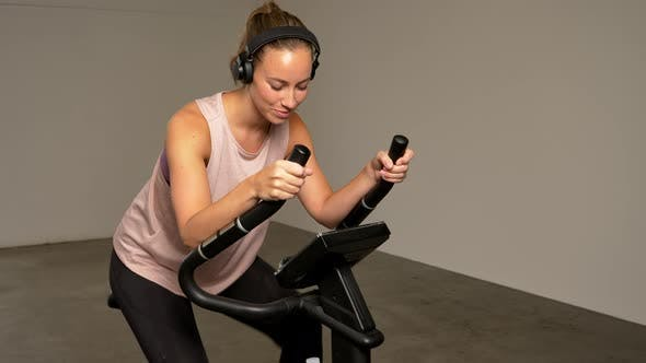 Thumbnail for Athletic Lady Riding on the Stationary Bike