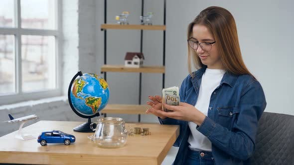 Thumbnail for Handsome Caucasian Woman Counting Money for Trip